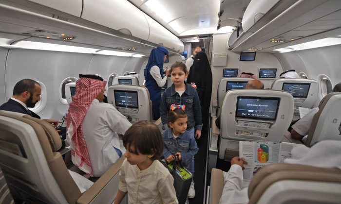 Passengers on the first Saudia Airlines direct flight from Jeddah to the Iraqi city of Arbil, on Oct. 1, 2018. (Amer HILABI /AFP/Getty Images)