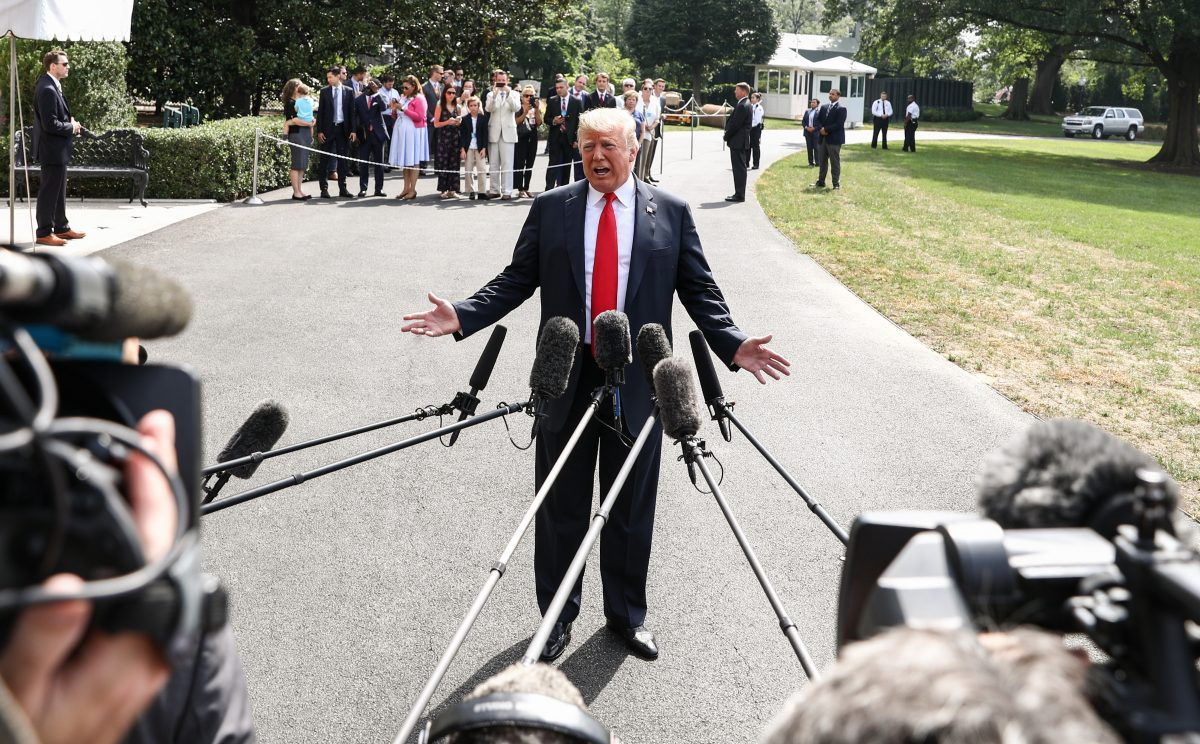President Donald Trump talks to the media before leaving to Bedminster, N.J., at the White House in Washington