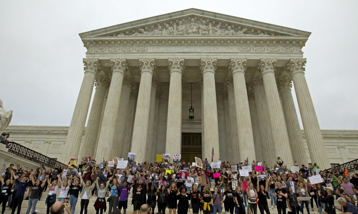 Demonstrators take to the steps of the Supreme  Court as they protest against the appointment of Supreme Court nominee Brett Kavanaugh on Capitol Hill in Washington, Oct. 6, 2018. (Jose Luis Magana / AFP)