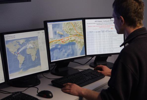 Mathias Hoffmann of the German Research Centre for Geosciences (GFZ) - Helmholtz Centre Potsdam monitors screens of their own developed GEOFON software, an earthquake alert system in Potsdam, Germany on Jan. 13, 2010. (Andreas Rentz/Getty Images)
