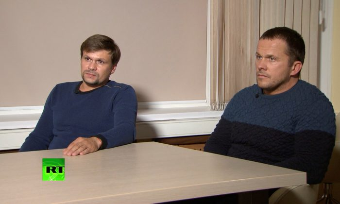 """""""Alexander Petrov"""" and """"Ruslan Boshirov"""" during an interview at an unidentified location in Russia on Sept. 13, 2018. (RT/Handout via Reuters TV)"""