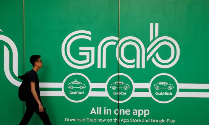 A man walks past a Grab office in Singapore March 26, 2018. (Reuters/Edgar Su/File Photo)