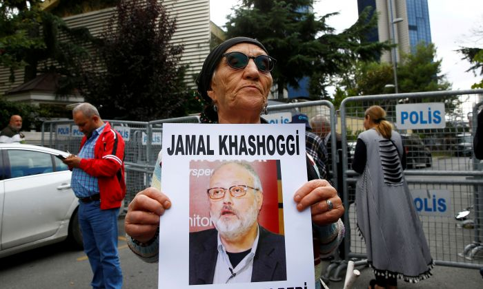 A human rights activist holds picture of Saudi journalist Jamal Khashoggi during a protest outside the Saudi Consulate in Istanbul, Turkey, on Oct. 9, 2018. (Osman Orsal/Reuters)