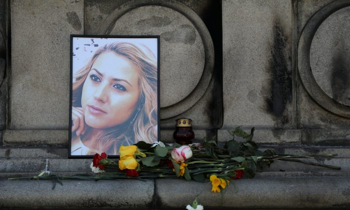 Flowers and candles are placed in memory of Bulgarian TV journalist Viktoria Marinova in Ruse, Bulgaria, on Oct. 9, 2018. (Stoyan Nenov/Reuters)