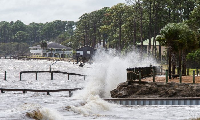 Waves crash against a home seawall as Hurricane Michael approaches in Eastpoint, Fla. on Oct. 9, 2018. Mark Wallheiser/Getty Images