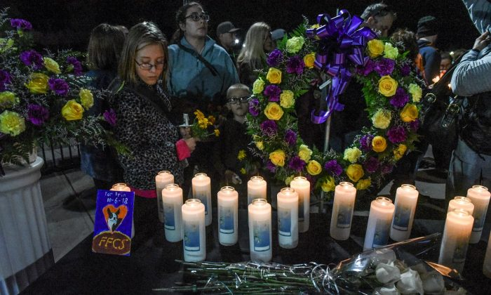 Mourners attend a candlelight vigil in Amsterdam, N.Y., on Oct. 8, 2018, for the victims of the limousine crash that killed 20. (Stephanie Keith/Getty Images)
