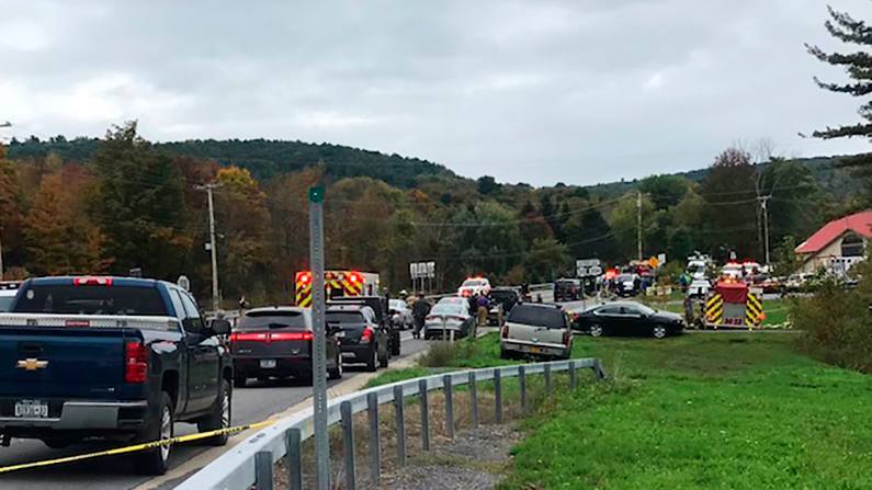 Emergency personnel respond to the limousine crash