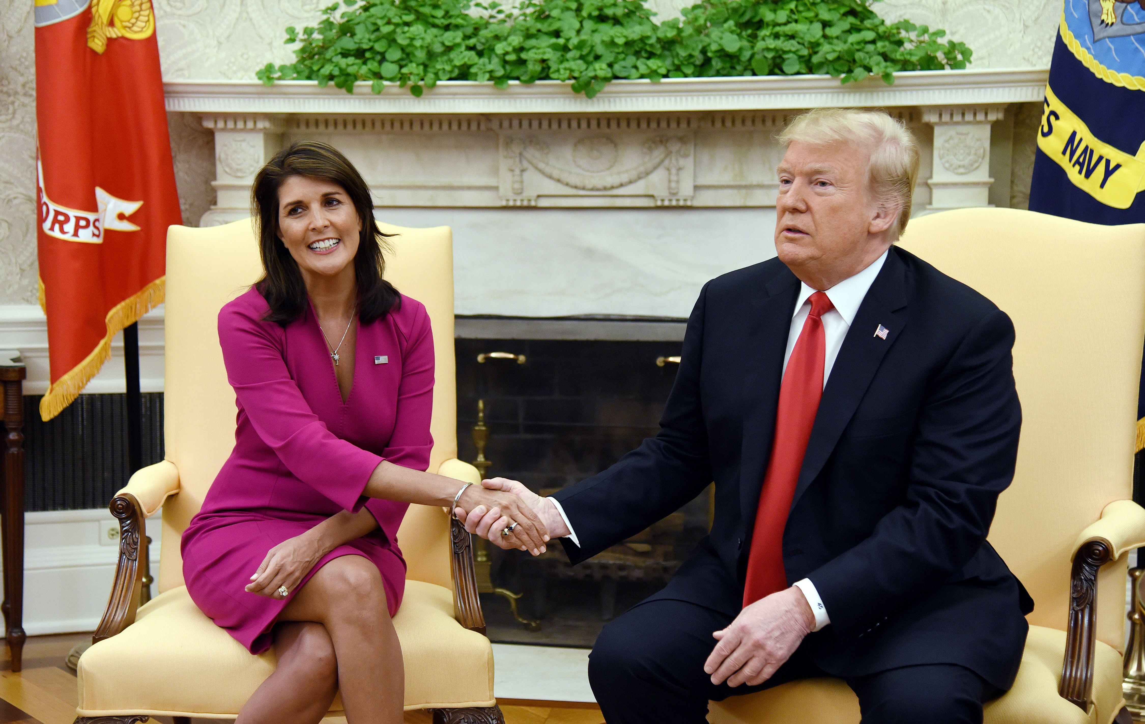 President Donald Trump shakes hands with Nikki Haley