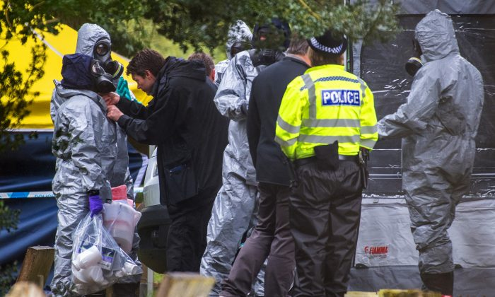 Police officers wear protective suits and breathing apparatus in London Road cemetery as they continue investigations into the poisoning of Sergei Skripal who was found critically ill on a bench in Salisbury, England, on March 10, 2018. (Chris J Ratcliffe/Getty Images)