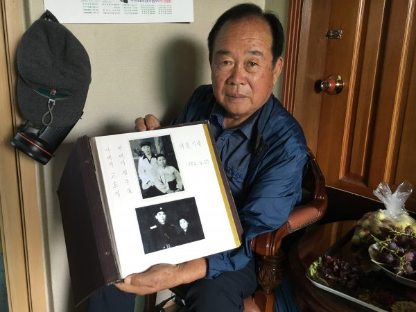Koh Ho-jun shows photos of his brother's engagement in North Korea.