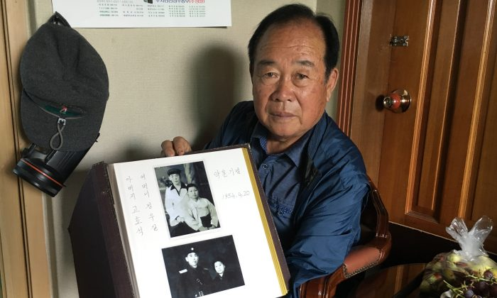Koh Ho-jun shows photos of the engagement of his brother, Koh Ho-seok, to his wife in North Korea which Koh Ho-jun received during an inter-Korean family reunion, in his home in Cheongju, South Korea, on Oct. 2, 2018. (Seungmock Oh/Special to The Epoch Times)