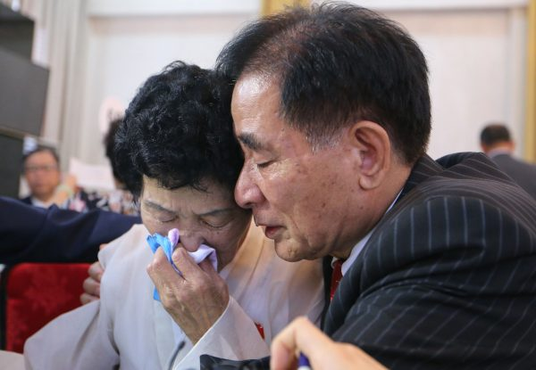 North Korean Jang Gi Sun, 77, cries with her South Korean brother Jang Ju-hwan.