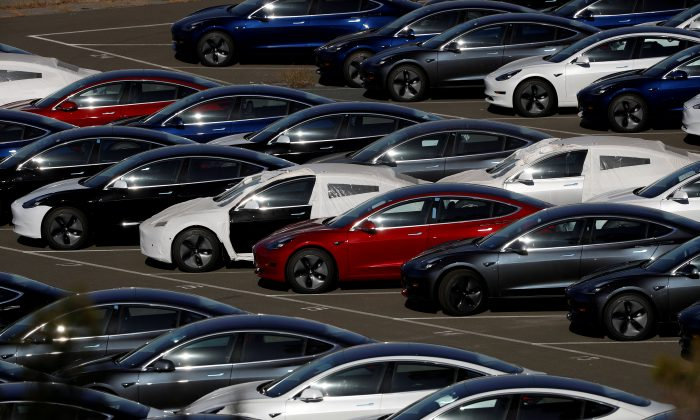 Rows of the new Tesla Model 3 electric vehicles are seen in Richmond, California, on June 22, 2018.  (Stephen Lam/Reuters)