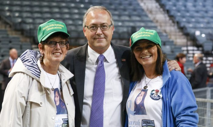 Michelle Root (R), with friend Peggy Griffin and Rep. David Young (R-Iowa) after the Make America Great Again rally in Council Bluffs, Iowa, on Oct. 9, 2018. (Charlotte Cuthbertson/The Epoch Times)