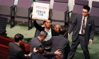 Some Hong Kong Lawmakers Walk Out of Policy Address Over Media 'Persecution'