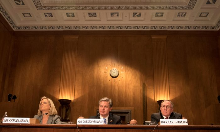 "Homeland Security Secretary Kirstjen Nielsen, FBI Director Christopher Wray, and Russell Travers, Acting Director of National Counterterrorism Center, testify before a Senate Homeland Security and Government Affairs Committee hearing on ""Threats to the Homeland"" at the Dirksen Senate Office Building in Washington, D.C., on Oct. 10, 2018. (Alex Wroblewski/Reuters)"