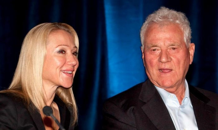 Magna International Inc. chairman Frank Stronach and executive vice-chair Belinda Stronach chat at the company's annual general meeting in Markham, Ontario on May 6, 2010. (The Canadian Press/Frank Gunn)