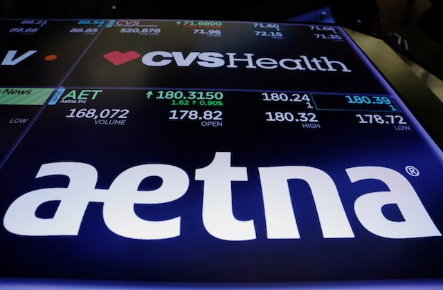Logos of CVS and Aetna are displayed on a monitor above the floor of the New York Stock Exchange shortly after the opening bell in New York, on Dec. 5, 2017. (Reuters/Lucas Jackson)