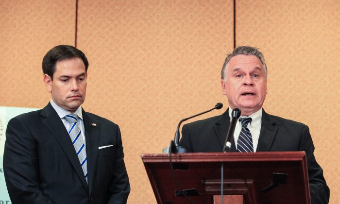 Rep. Chris Smith (R-NJ) (R), CoChairman of the Congressional-Executive Commission on China (CECC), and Sen. Marco Rubio (R-FL) Chairman of CECC, speak on the release of the 2018 Annual Report of the Commission on human rights conditions and rule of law developments in China, in Washington, on Oct. 10, 2018. (Jennifer Zeng/The Epoch Times)