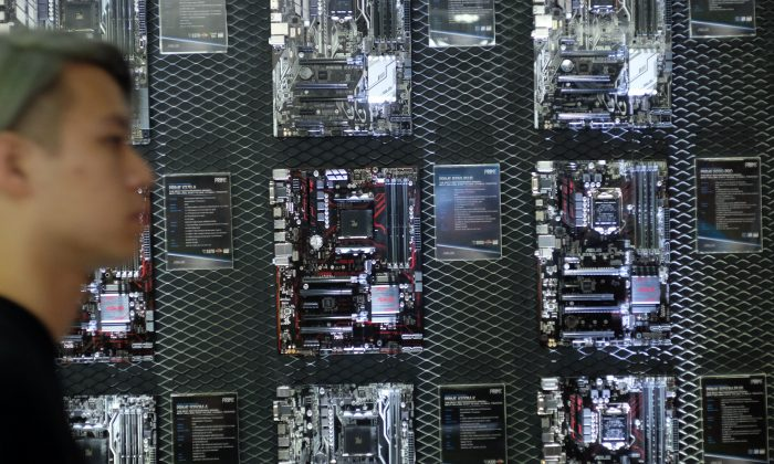 A visitor walks past a motherboard wall during the Computex Show in Taipei, on May 30, 2017. (SAM YEH/AFP/Getty Images)