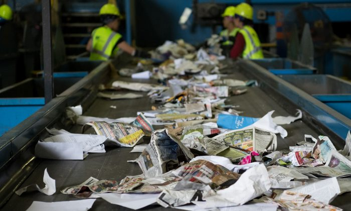 Workers sort recycling material at the Waste Management Material Recovery Facility in Elkridge, Maryland, June 28, 2018. (Saul Loeb/AFP/Getty Images) (Saul Loeb/AFP/Getty Images)