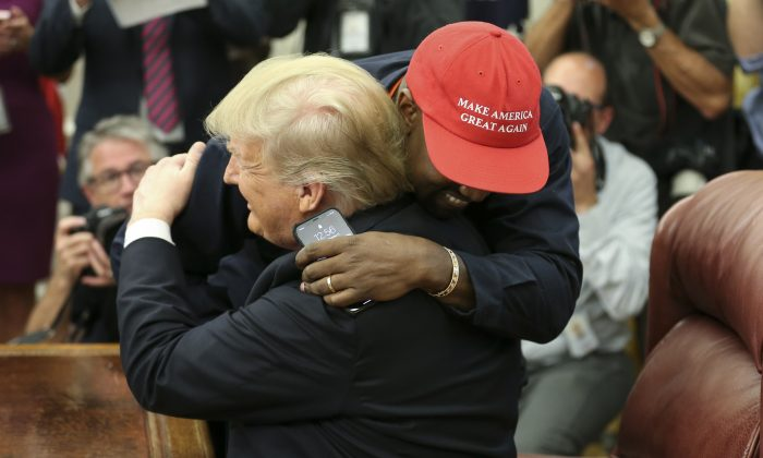 President Donald Trump hugs rapper Kanye West during a meeting in the Oval Office of the White House in Washington on Oct. 11, 2018. (Oliver Contreras - Pool/Getty Images)