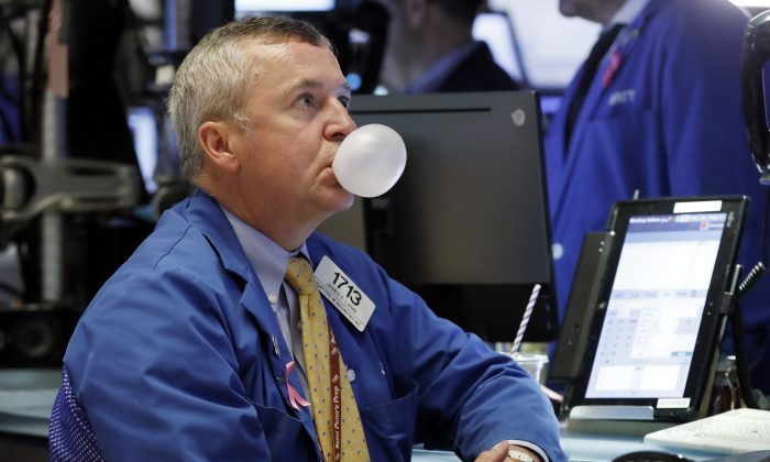 Trader James Lamb watches his screens on the floor of the New York Stock Exchange, Oct. 10, 2018. Stocks are extending their slump on Wall Street, led by drops in big technology companies, as rising bond yields draw investors out of stocks. (AP Photo/Richard Drew)