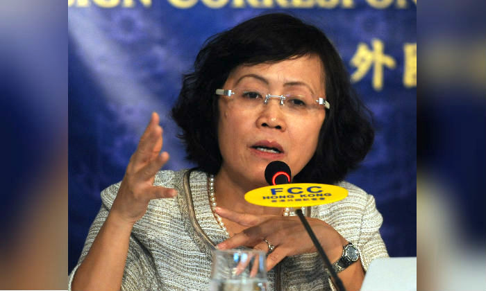 Hu Shuli, co-founder of China's state-owned Caixin Media, speaks at the foreign correspondents club in Hong Kong on July 11, 2011. Caixin Media was established in January 2010. (Mike Clarke/AFP/Getty Images)