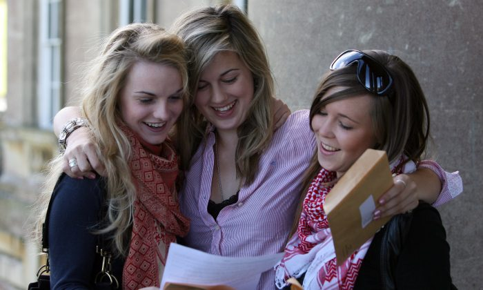 Students receive their exam results in Bath, United Kingdom, in this undated file photo. (Matt Cardy/Getty Images)