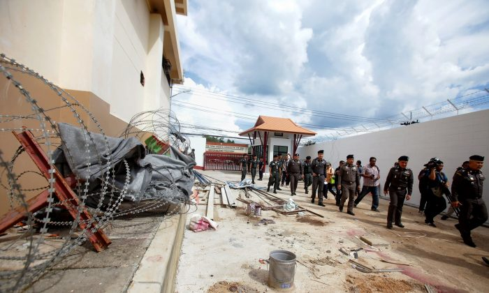 A manhunt was underway for 20 ethnic Uyghurs from China who made a daring escape from an immigration detention center in Sadao district, Songkhla Province in Thailand on Nov. 21, 2017. (Tuwaedaniya Meringing/Getty Images)