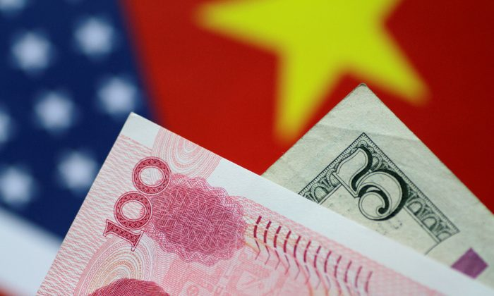 U.S. Dollar and China Yuan notes are seen in this picture illustration on June 2, 2017. (Thomas White/Reuters)