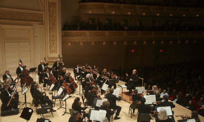 An orchestra performs on stage, in this file photo. (Steve J. Sherman)