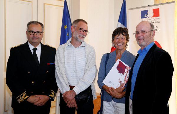 Amanda Holmes and her husband Robin hold a French naturalization decree