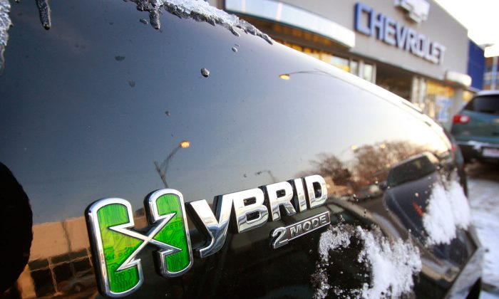 A Hybrid Chevrolet Tahoe sits in front of a dealership, in Chicago, Illinois. (Scott Olson/Getty Images)