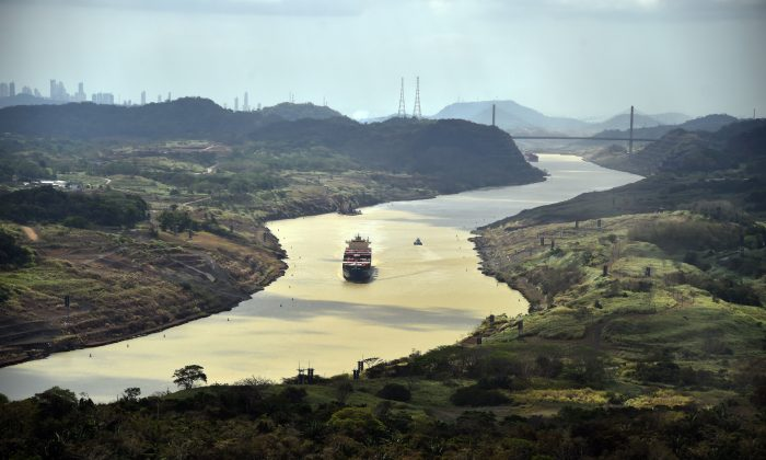 A merchant ship sails along the Panama Canal, in this file photo. China is continuing its push to displace U.S. influence in the region, and already has put parts of the Panama Canal under its control. RODRIGO ARANGUA/AFP/Getty Images