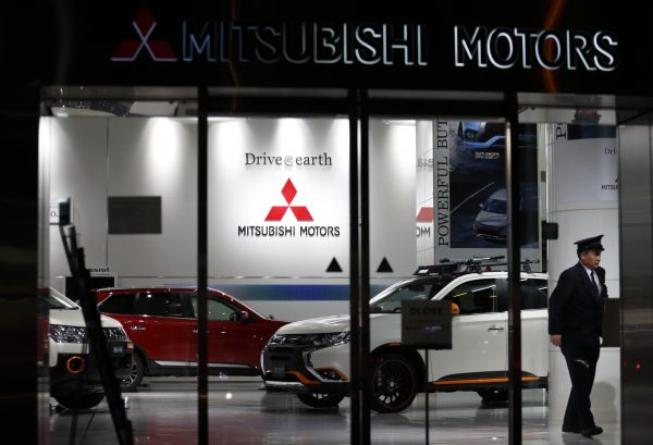 security worker walks past Mitsubishi