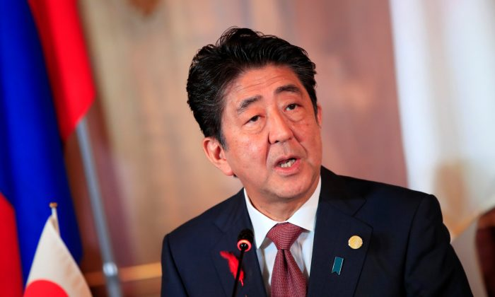 Japanese Prime Minister Shinzo Abe attends the joint news conference of the Japan-Mekong Summit Meeting at the Akasaka Palace State Guest House in Tokyo on Oct. 9, 2018. (Franck Robichon/Reuters)