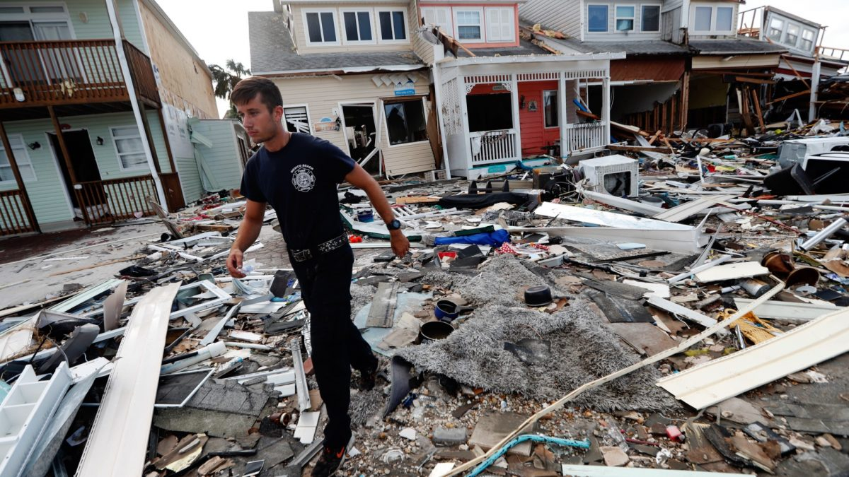 Firefighter performs door search Hurricane Michael