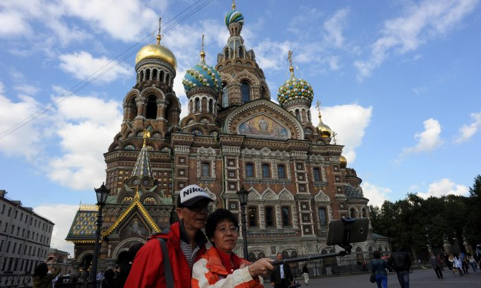 """Chinese tourists take a """"selfie"""" in front of Church of the Savior on Blood in central St. Petersburg, Russia, on Sept. 4, 2015. (OLGA MALTSEVA/AFP/Getty Images)"""
