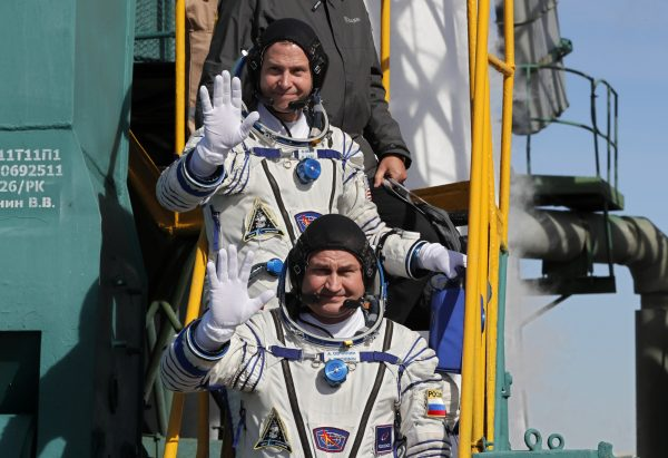 International Space crew board Soyuz