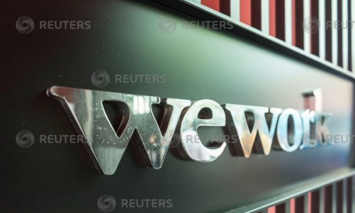 A logo of U.S. co-working firm WeWork is pictured during a signing ceremony in SHANGHAI, China Apr. 12, 2018. (Jackal Pan via Reuters)