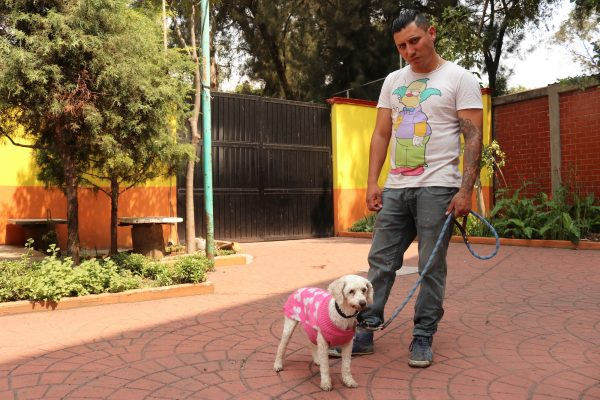 Animal care attendant Jair Rodriguez with rescued dog Hannah.