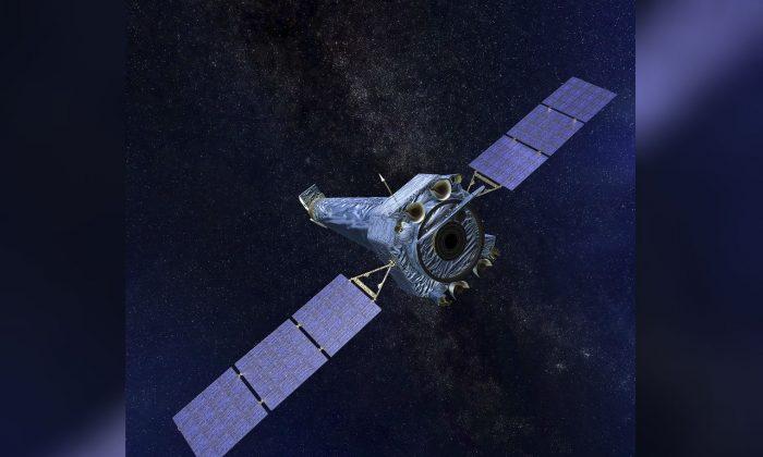 This illustration made available by NASA shows the Chandra X-ray Observatory on Oct. 12, 2018. (NASA/CXC/SAO via AP)