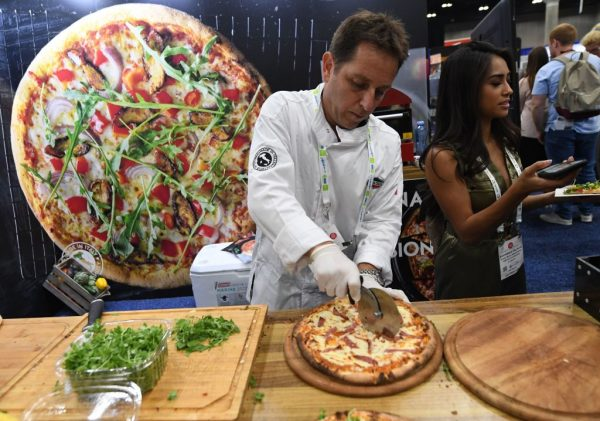 a pizza chef at work