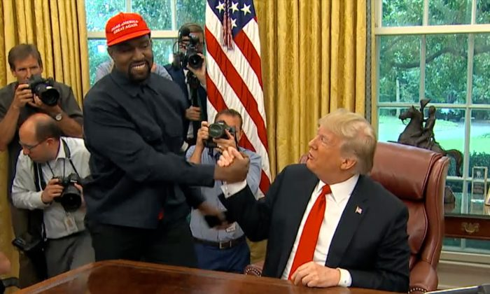 President Donald Trump greets rapper Kanye West during a meeting in the Oval office of the White House in Washington on Oct. 11, 2018. (Screenshot/AP)