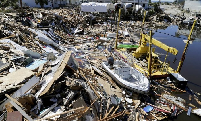 Boats are seen among the rubble along the canals Oct. 12, 2018, in Mexico Beach, Fla., two days after a Category 4 Hurricane Michael devastated the small coastal town just outside PANAMA CITY, Fla.  (Pedro Portal/Miami Herald via AP)