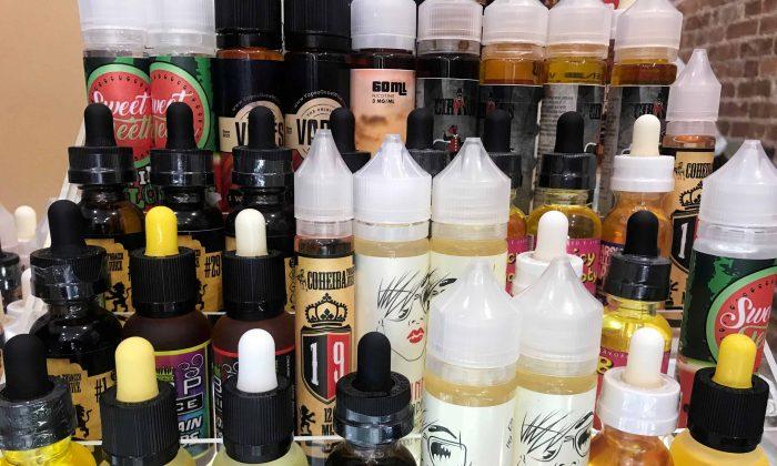 Vape liquids are displayed at the shop Cloud99 Vapes in Manhattan borough, New York, on Sept. 20, 2018. (Melissa Fares/Reuters)