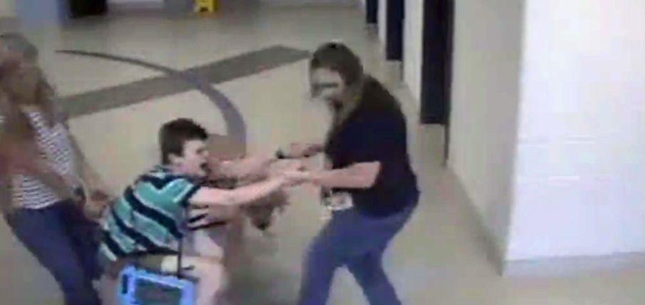 child with autism dragged thru school