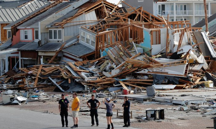 Rescue personnel perform a search in the aftermath of Hurricane Michael in Mexico Beach, Fla., on Oct. 11, 2018. (Gerald Herbert/AP)
