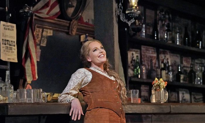 "Can one woman tame the wild West? Eva-Maria Westbroek (C) as Minnie in Puccini's ""La Fanciulla del West"" proves she can. (Ken Howard / The Metropolitan Opera)"